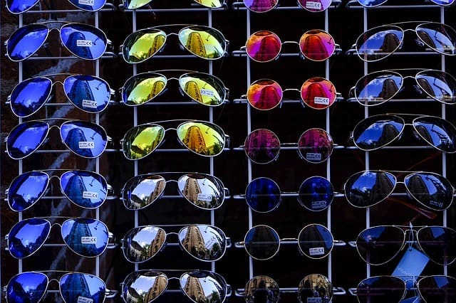 colorful and best sunglasses for men displayed on a rack