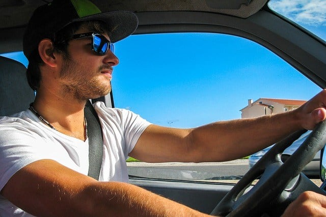 a man wearing sunglasses while driving