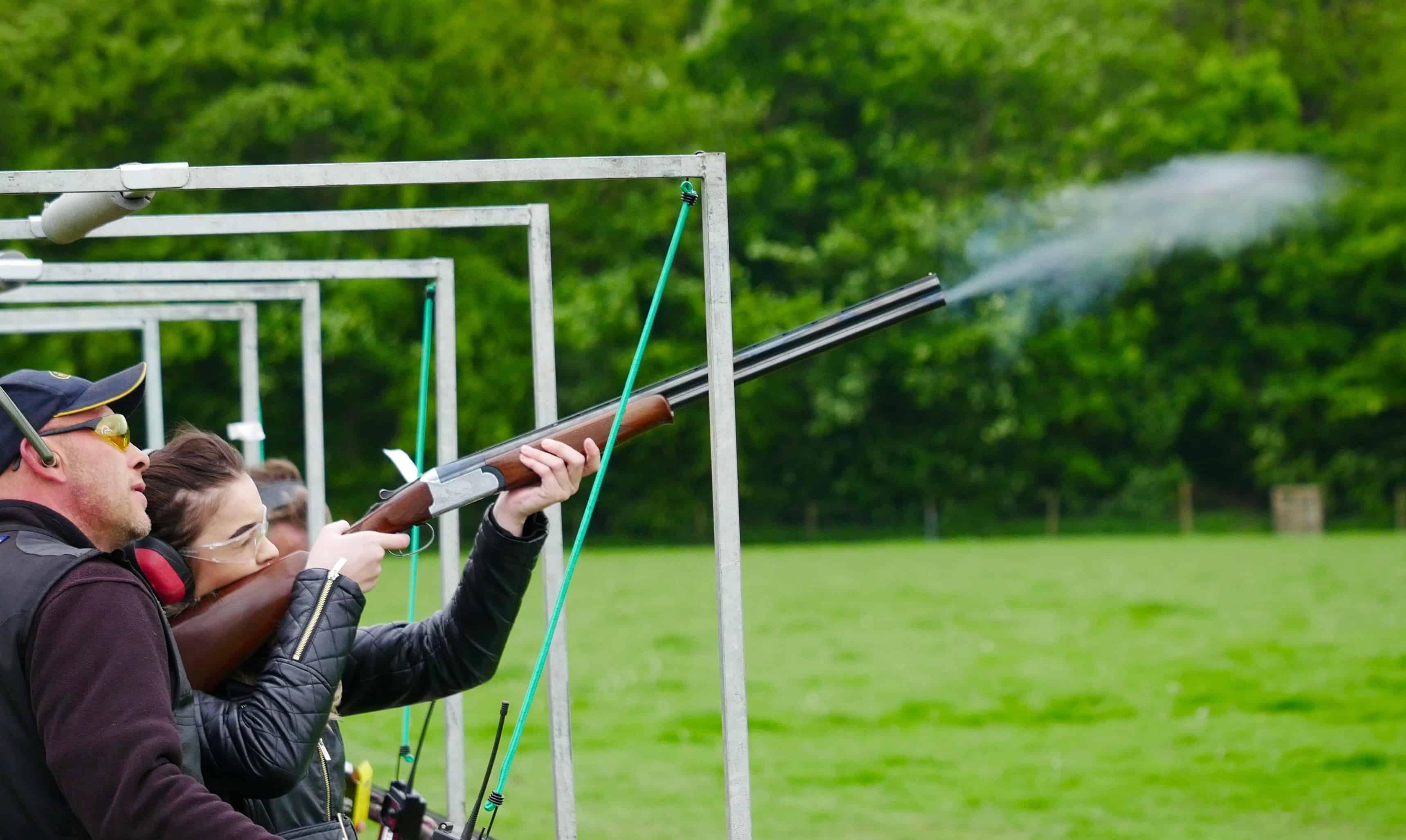 man and woman on a shooting range