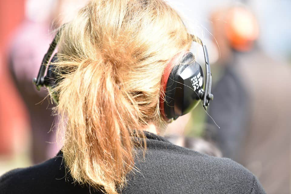 woman wearing earmuffs
