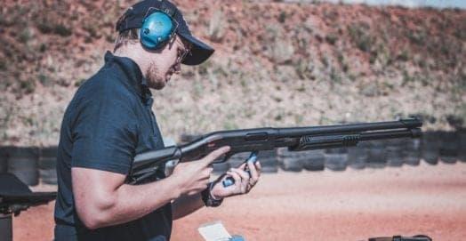 man reloading shotgun