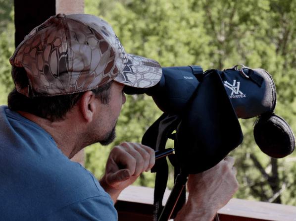 man using rangefinder