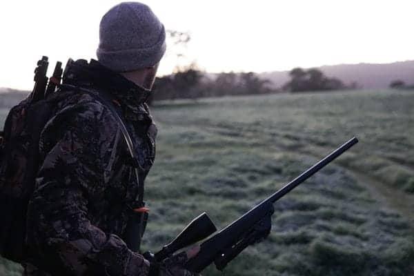 armed man wearing bonnet