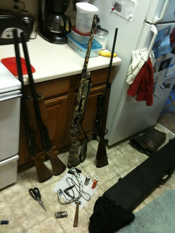 rifles and cleaning tools