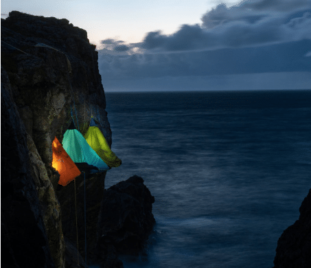 tent with lights-hanging-on-cliff