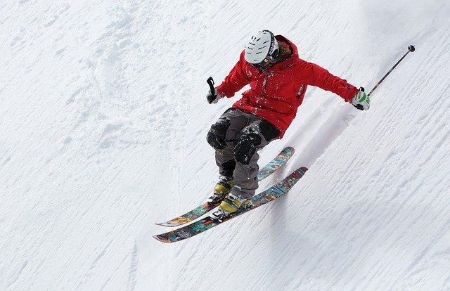 man skis at snow