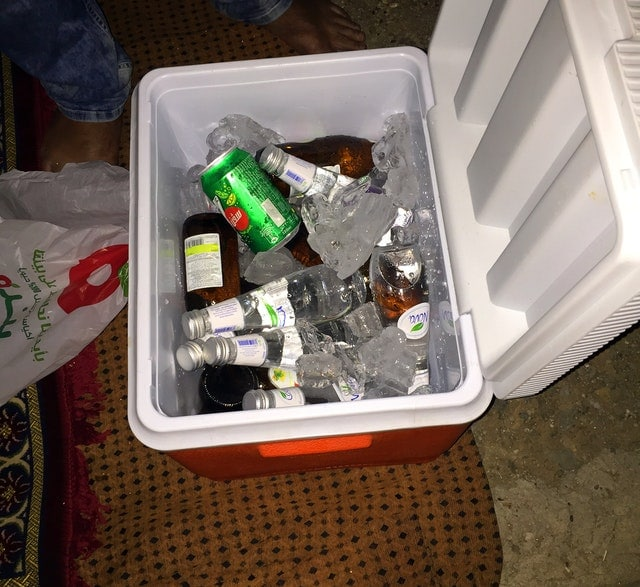 ice cooler full of ice and drinks