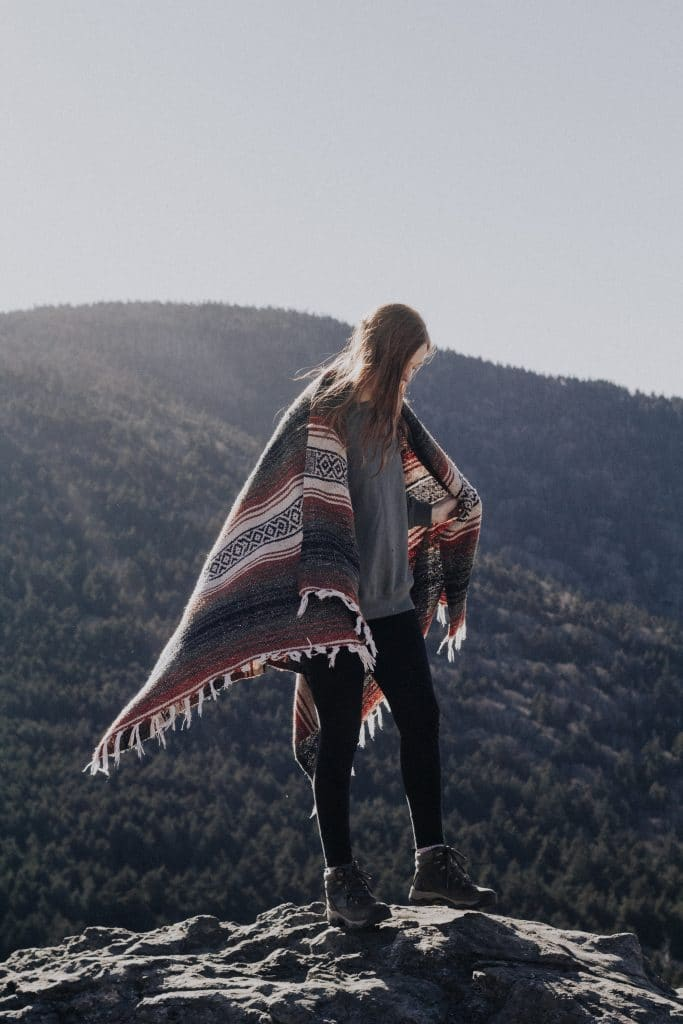 a woman with blanket on her back