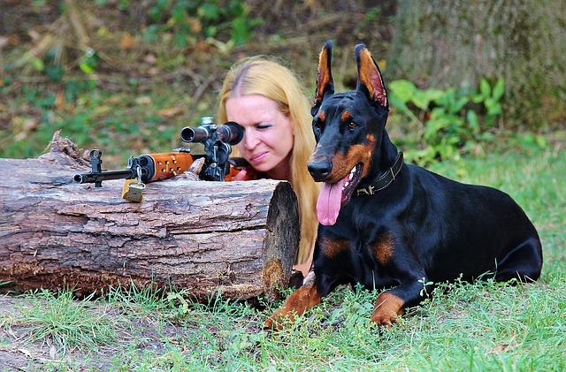 photos/weapon-doberman-dog-woman-pistol
